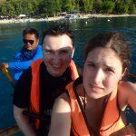 Rowing toward the sharks. Veronika is scared.
