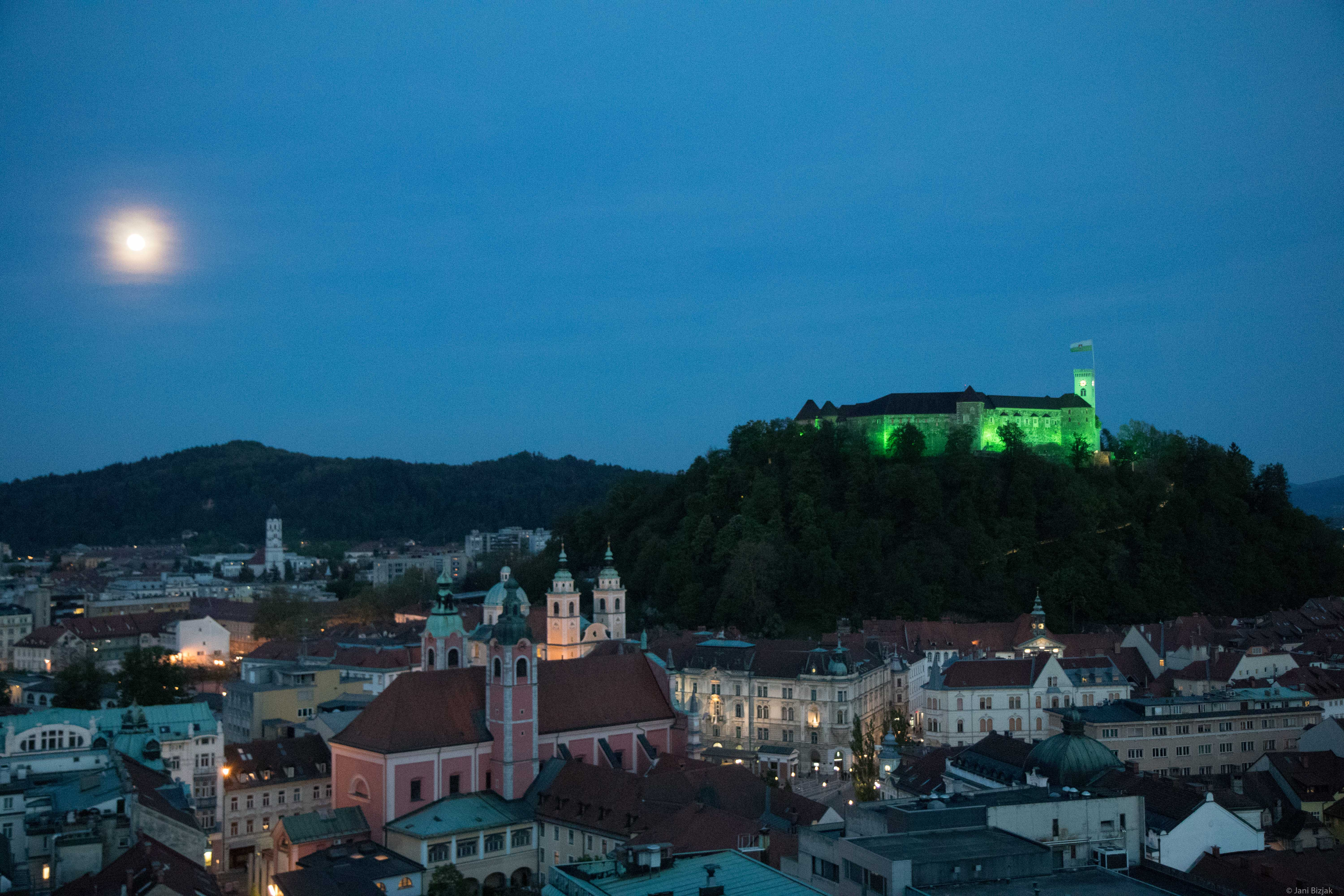 Ljubljana castle colored green for the green capital of Europe.