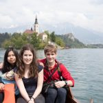 Island in lake Bled and us in the boat.