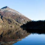 Lake so calm that it looks like mirror.