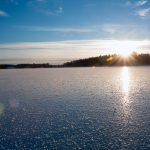 Walking over frozen lake.