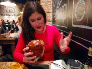 Veronika enjoining her burger, while I did a fatal mistake and took a burger with pancakes instead of bread buns. :(