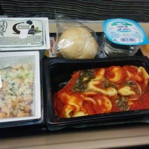 Plane food on Etihad airways. Some tortellini with tomato.