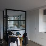 A bit of kitchen and bedroom