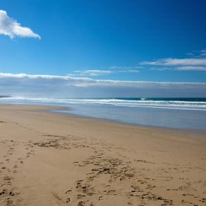 Long sandy beaches, with about 2m waves.