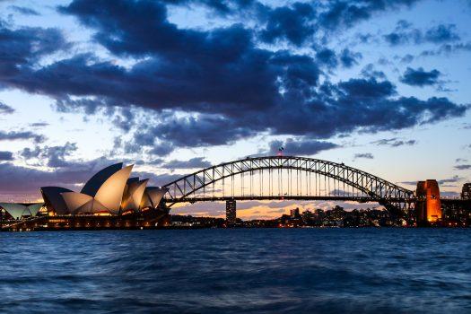 Sydney opera and Harbour bridge at dusk.