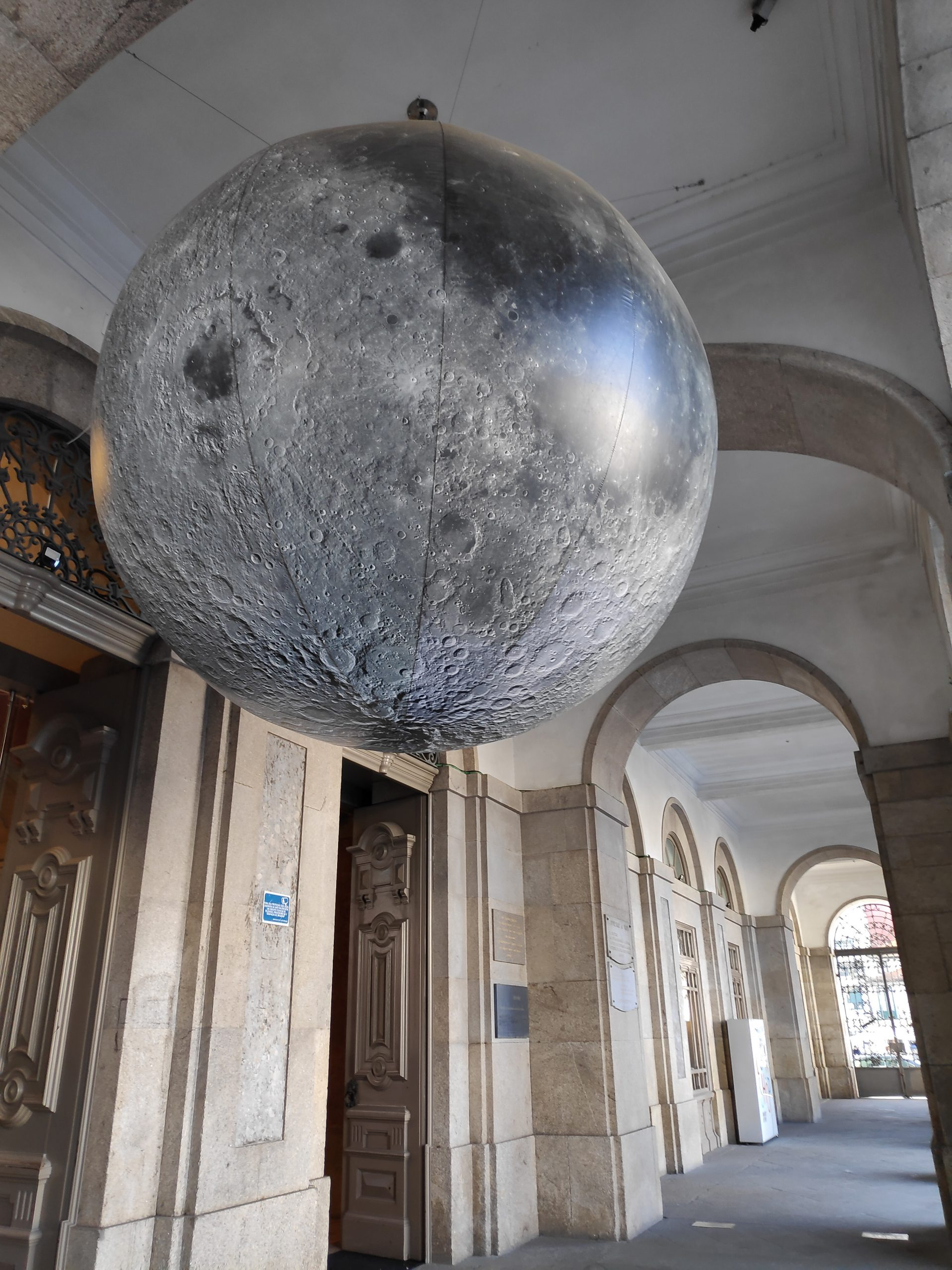 Gigantic moon in front of a museum.