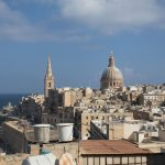 Enormous cathedrals rise above the roofs of Valletta.